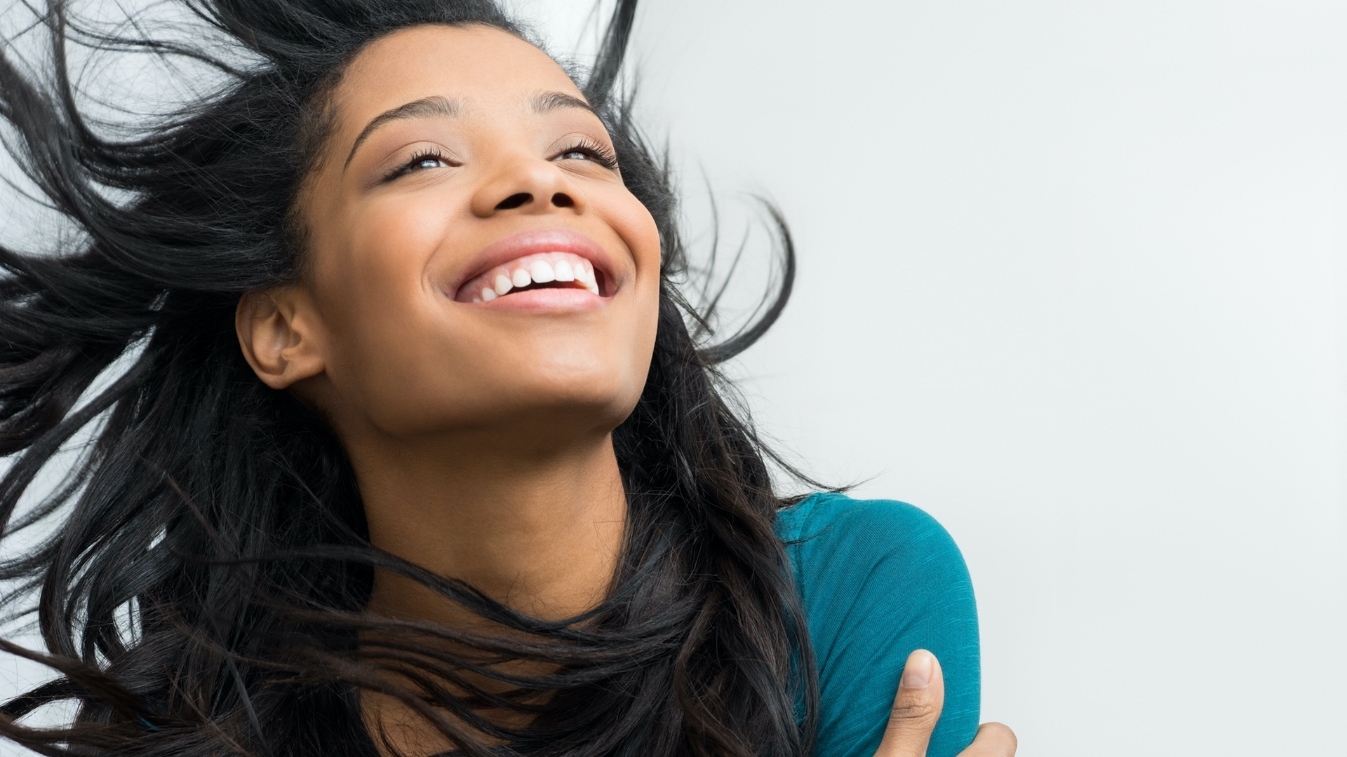 Happy woman with Brazilian Straight Hair Extensions